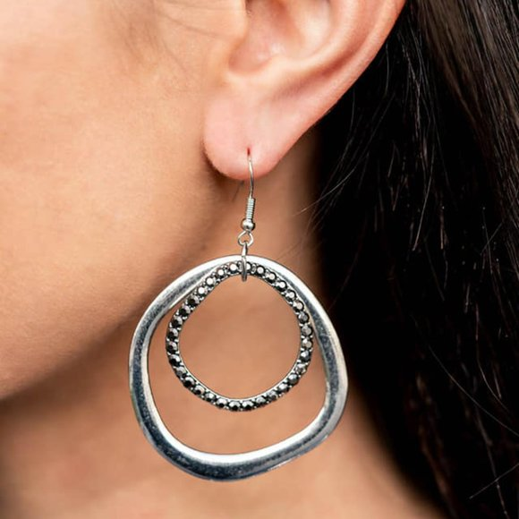 Spinning With Sass Silver Earrings